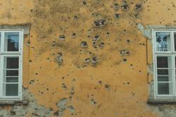 from serbian croatian war, bullet  holes on the yellow wall at croatia