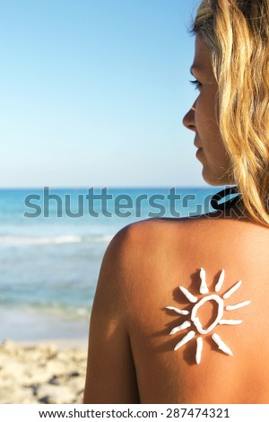from sun cream on the female back on the seaside #287474321