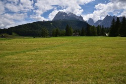 From the meadows of the village of Moso, a view of the Dolomites of the Val Fiscalina with the Costone della Croda Rossa and Cima Uno