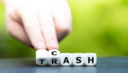 From trash to cash. Hand turns dice and changes the word