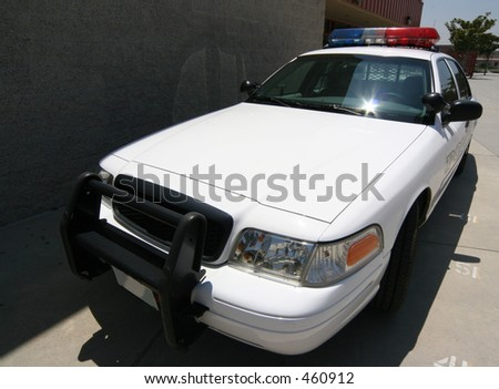 front angle of modern police car on campus