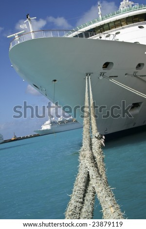 front (bow) of a cruise ship tied up to the dock  with rope