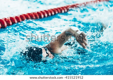 Front crawl swimmer in the pool