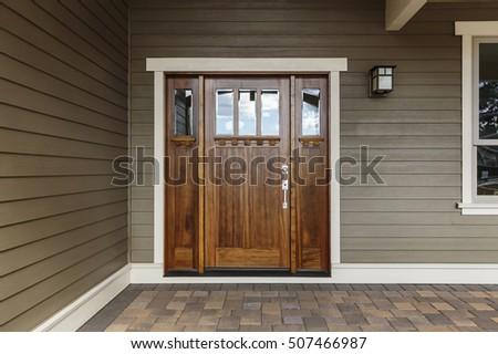 Front dark brown door that is closed
