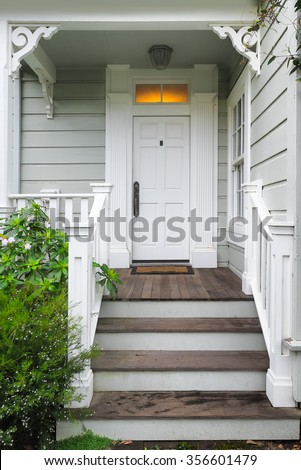 Front door and porch of a Victorian house or cottage