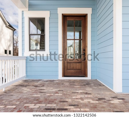 Front door, brown front door with light blue exterior #1322142506