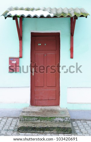 Front door in an old dilapidated house.