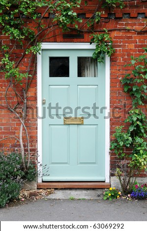 Front Door of a Beautiful Red Brick House - stock photo