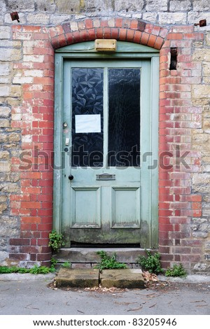 Front Door of a Derelict House - stock photo