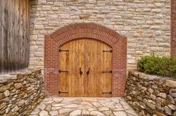 Front door of a rustic wine cellar.
