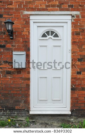 Front Door of an English Red Brick London Town House - stock photo