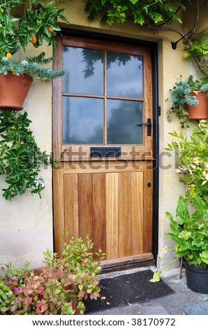 Front Door of an Old Cottage, Surrounded by Plants