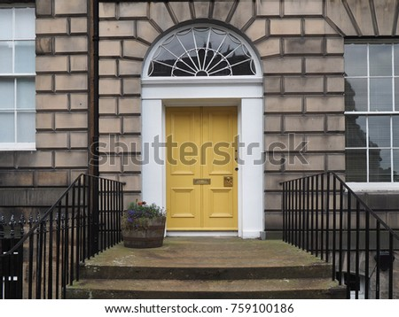 front door of old stone apartment building or office building #759100186
