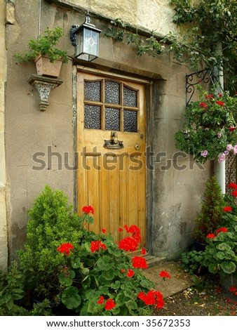 Front Door Old Cottage, Surrounded by Flowers and Greenery