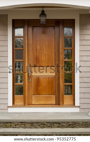 Front door showing hanging light fixture
