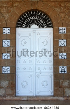 Front door to Bahai Temple with religion symbols