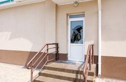 Front door with a broken window pane. Property insurance, vandalism concept.