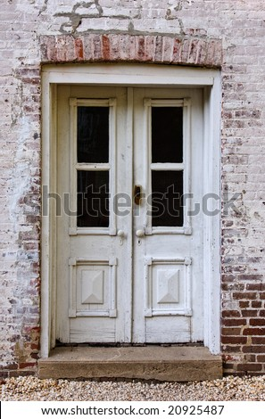 Front doors of an old brick building - stock photo