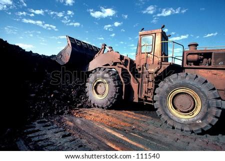 Front End Loader moving ore stockpile
