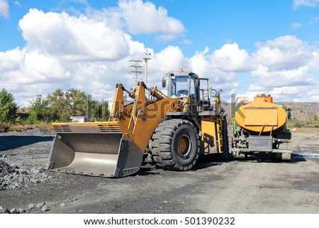 Front end loader or pay loader in operations action