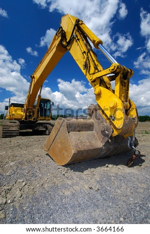 Front End Loader With A Big Bucket, On A New Construction Site - stock photo