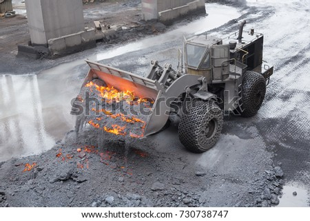 front end loaders with traction chains on wheels removing hot slag from electric arc furnace   #730738747