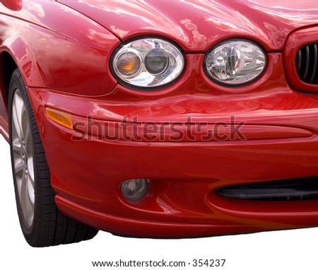 Front end of a red spots car isolated over white background