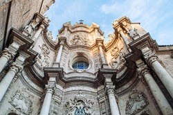 Front entrance facade of Torre del Micalet at Valencia cathedral. Famous attraction in old town area. Spain.