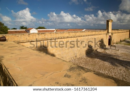 front entrance of Dutch historical 17th century fort near the shoreline on the beach