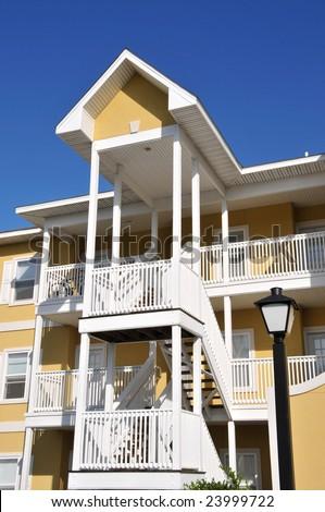 Front Facade of a brightly colored Condominium - stock photo