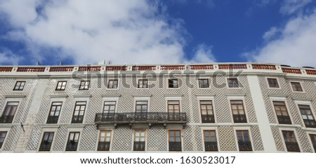 Front facade of a building with beige color in Lisbon, Portugal