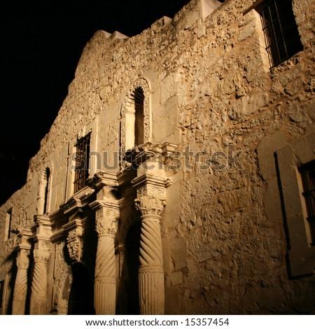 front facade of Alamo San Antonio illuminated at night
