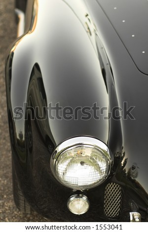 Front fender and headlight of AC Shelby Cobra classic car