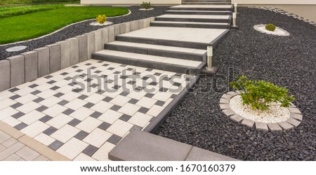 Front garden with external staircase made of prefabricated concrete parts concrete paving and stelae Foto d'archivio ©