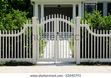 Front gate and picket fence on elegant house entrance