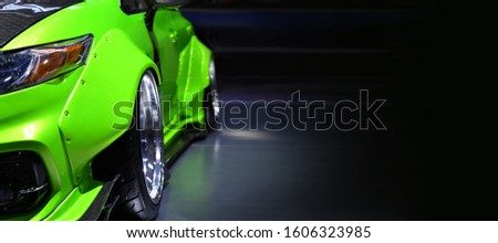Front headlights of green modify car on black background,copy space Stock photo ©