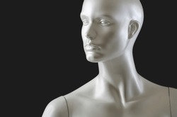 front image of shiny white female mannequin doll on a black background. front image of a display dummy figure