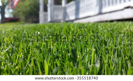 Front lawn of colonial house with American flag #355518740