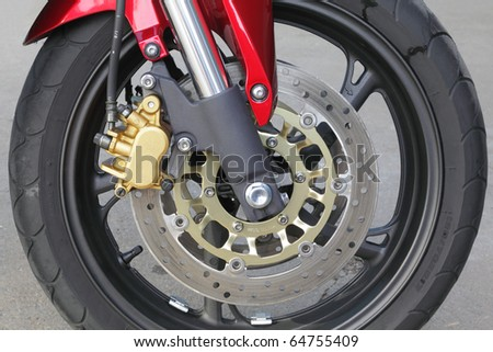 Front motorcycle disk breaks and tire in close up