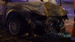 Front of a burned car after heavy collision - winter street of Warsaw, Poland night