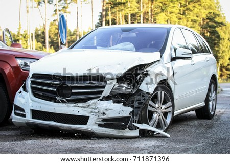 Front of a car get damaged by crash accident on the road #711871396