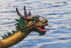 Front of a dragon boat head Races the real highlight of the festival is the fierce-looking dragon boats racing in a lively, colourful spectacle.Dragon boat racing festival in Hong Kong.
