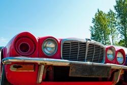 Front of a Jaguar XJ6 in a junkyard