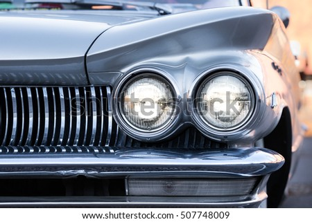 Shutterstock Front of a silver colored classic american automobile from the fifties. (1959)