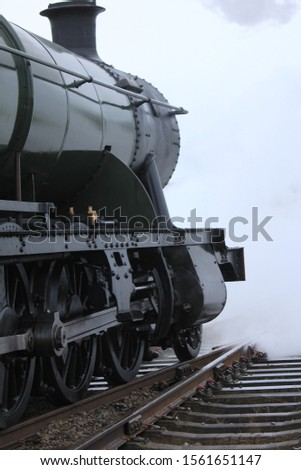 Front of a steam train with steam #1561651147