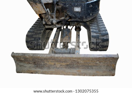 Front of a used small excavator isolated in a white background showing caterpillars and shovel