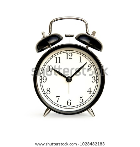 Front of black alarm clock analog classic vintage style. Isolated on white background.