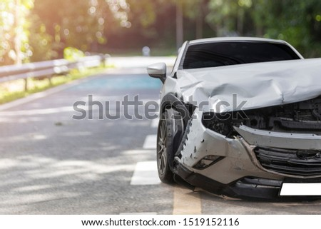 Front of light gray car big damaged and broken by accident on city street parking can not drive any more. With copy space for text or design Stockfoto ©
