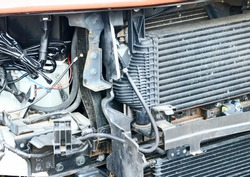 Front of motor car in a repair shop with its internals exposed