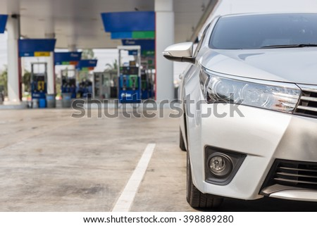 Front of new silver car parking in gas station in Thailand